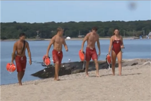 Summer Jobs: New Bedford Lifeguards walking along West Beach